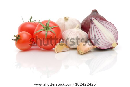 tomatoes, garlic and onion on a white background with reflection closeup