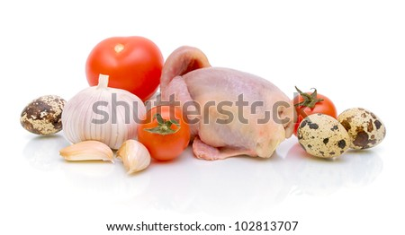 tomatoes, garlic, quail eggs and quail carcass on a white background