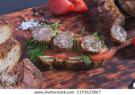 Tomatoes, herbs and bread. Homemade sausage and homemade bread. Diagonal composition. #1193623867