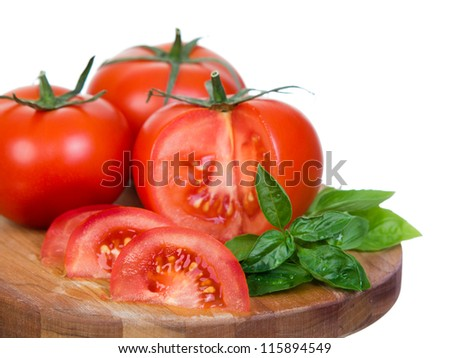 Tomatoes horizontal closeup  presentation sliced on wooden plank isolated on white background