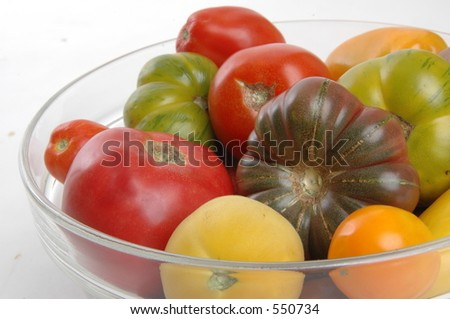 tomatoes in glass bowl