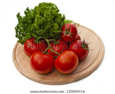 Tomatoes on a cutting board isolated over white