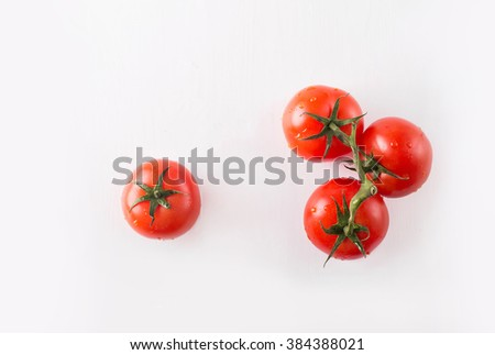 Tomatoes on a white background #384388021