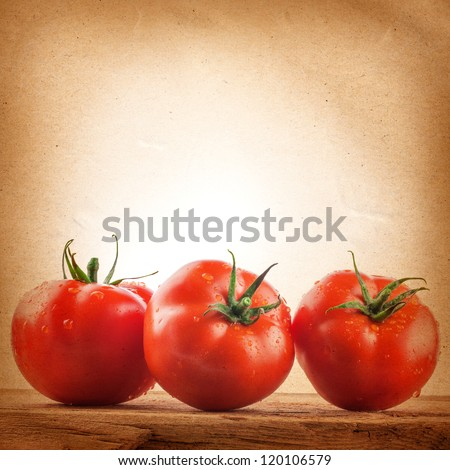 Tomatoes on the grunge yellow paper background. Farmers Vegetable Market