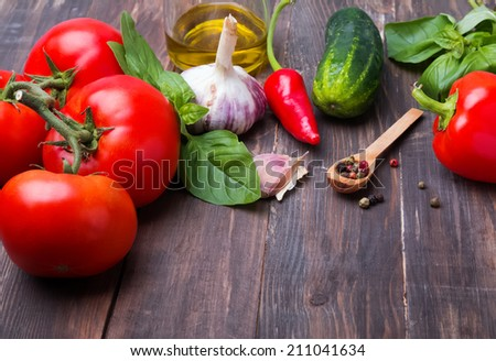 Tomatoes, paprika, basil and garlic on wooden table, ingredients for gazpacho #211041634