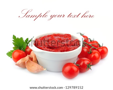 Tomatoes paste with spices and greens
