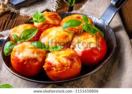 Tomatoes stuffed with rice and cheese from the oven