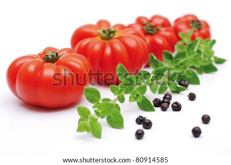 tomatoes, thyme and pepep black on a white background