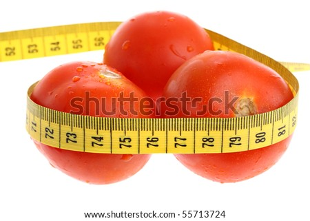 Tomatoes with yellow measuring tape as losing weight concept isolated on white