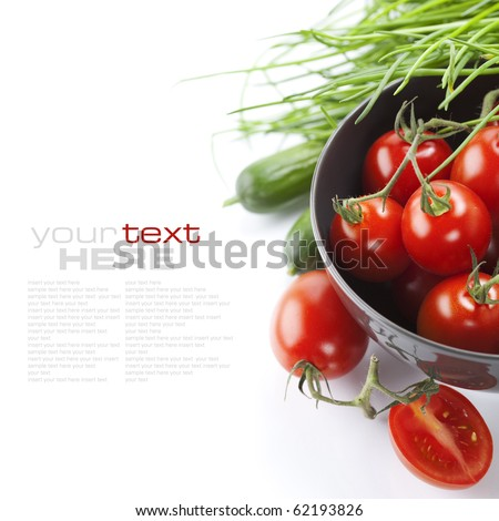 Tomatos chives and cucumbers on white background with sample text
