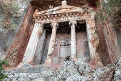 Tomb of Amyntas, also known as the Fethiye Tomb. View of the tombs carved into the rock from the time of the ancient state of Lycia. Amyntas ancient Lycian rock tombs in Pinara, Fethiye - Turkey