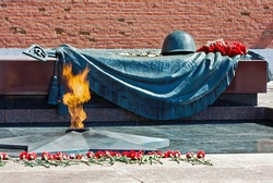 Tomb of the Unknown Soldier with eternal flame in Alexander Garden (Moscow). Russia