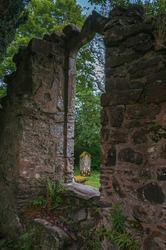 Tomb seen from a ruined window of the Balquhidder Parish church, Lochearnehed, Scotland. Concept: religion and spirituality, mysterious and fantastic places in scotland