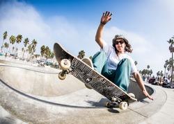 Tomboy Girl Skateboarding in Venice Beach