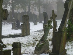 Tombs in cemetary in the snow winter