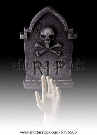 Tombstone with hand coming out of grave with fog