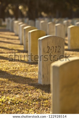 tombstone with the year 2012 written on it, signifying the end of 2012
