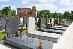 Tombstones and a chapel in the public cemetery