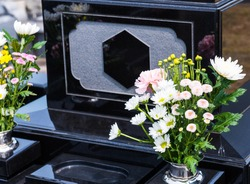 Tombstones and flowers. Grave image.