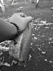 tombstones in burial sites, with a focus on the hands and black and white filters