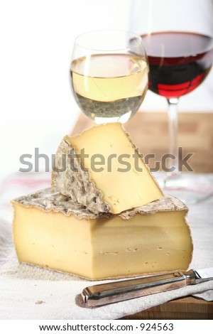Tomme de Savoie, a semi firm french cheese and two glasses of wine