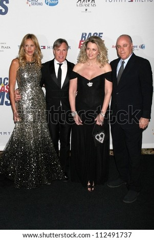 Tommy Hilfiger and Nancy Davis with guests at the 14th Annual \