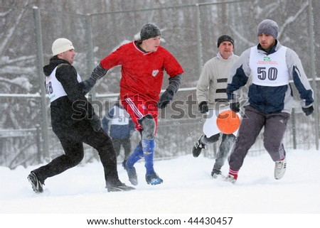 TOMSK, RUSSIA - DECEMBER 12: Playing football in the snow - traditional Siberian winter sport, December 12, 2009 in Tomsk, Russia.