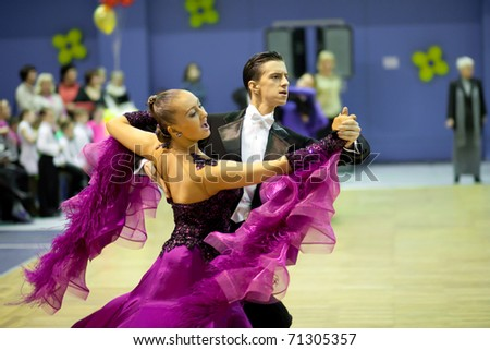 TOMSK, RUSSIA - FEB 14 : Couple dancing - Samigullin Alexander 18, Evdokimova Alina 18, (no 71) at sport dance competition of Tomsk region on February 14, 2011 in Tomsk, Russia.
