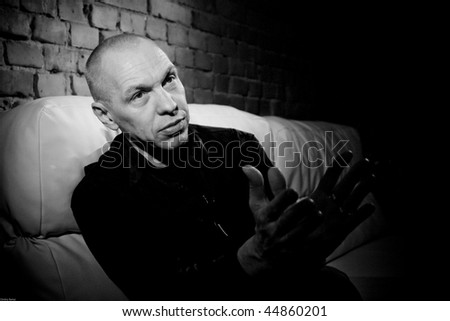 """TOMSK, RUSSIA - MARCH 4: Musician, songwriter, radio broadcaster and  founder and leader of the """"Va-Bank""""  Alexander F. Sklyar in club Underground, March 4, 2009 in Tomsk, Russia. - stock photo"""