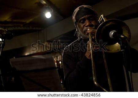 TOMSK, RUSSIA - OCTOBER 3: Musician Frank Ku-Umba frontman of Frank KuUmba Lacy Quartet (USA) in jazz club Underground on 1st International Festival of a clubs jazz, October 3, 2008 in Tomsk, Russia. - stock photo