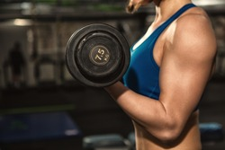 Tone up! Cropped shot of a fitness woman with strong toned fit body in sportswear doing biceps curls exercising at the gym copyspace workout training motivation lifestyle health active concept