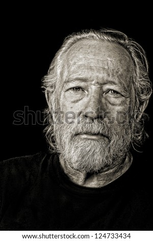 Toned black and white image of serious tough old man - stock photo