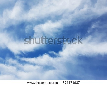 Toned emotional cloud and blue sky background. A fluctuation weather make a dreamy and imaginative cloudscape. Fresh and free natural wallpaper.
