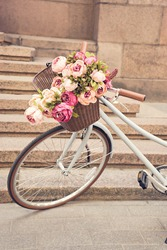 toned image of vintage bike with flowers