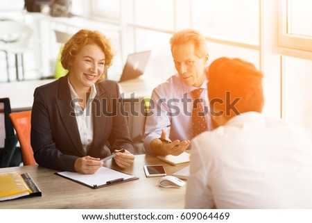 Toned of HR specialists taking interview in board room in office. Business people communicating about companies, firms or enterprises.