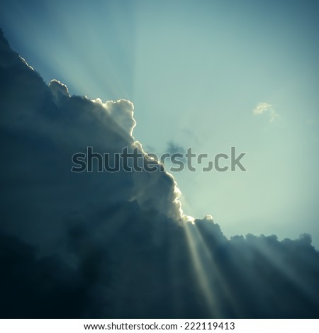 Toned photo of Dramatic Cloudscape Area with Ray of Light