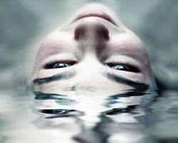 Toned Photo of Face in the Water