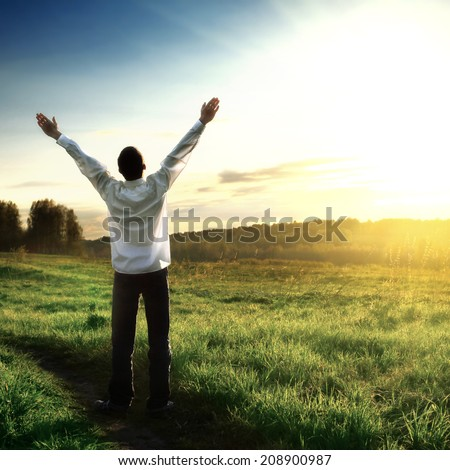 Toned photo of Happy Man silhouette on Sunset background