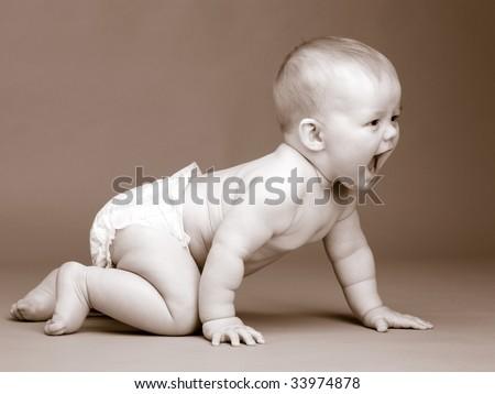 Toned photo of nine month baby, crawling