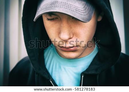 Toned Photo of Sad Teenager Portrait outdoor closeup