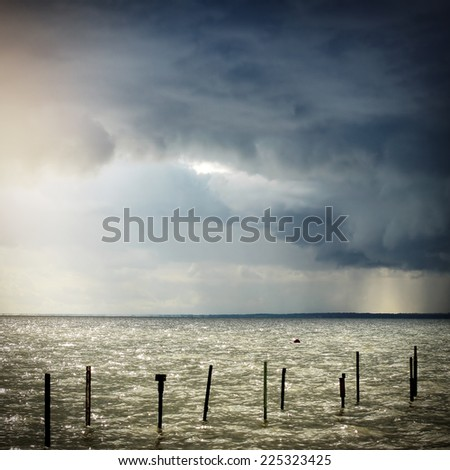 Toned Photo of Seaside Landscape with Thunderstorm Clouds