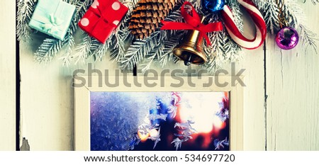 Toned picture, purple. Christmas background and white frame. Christmas decorations on a white vintage wooden background. Free space for text