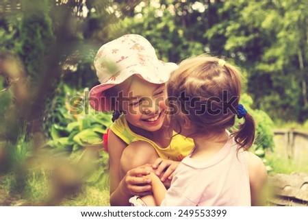 Toned Summer portrait of cute little girls #249553399