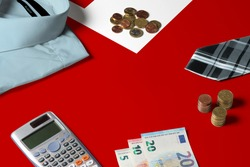 Tonga flag on minimal money concept table. Coins and financial objects on flag surface. National economy theme.
