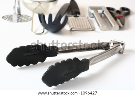 Tongs and other kitchen utensils in the background.