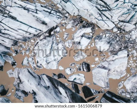 Tongue of Svinafellsjokull glacier, Iceland: Iceland glaciers are thinning more than a one meter in a year. Glacier pieces photographed straight from above.