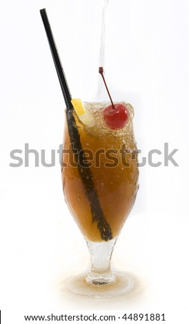 Tonic water pouring into a Long Island Ice Tea Rum cocktail, spilling over the glass  on white