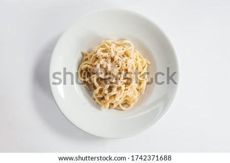 Tonnarelli cacio e pepe is a typical Lazio specialty, Italy, spaghetti with pecorino cheese and pepper isolated on white background Foto d'archivio ©