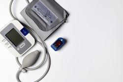 tonometer and pulse oximeter on white background