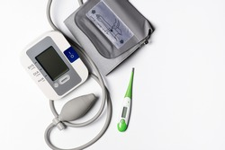tonometer and thermometer on a white background